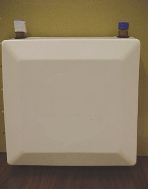 Photo 1. Example of a tankless water heater about the size of a large briefcase