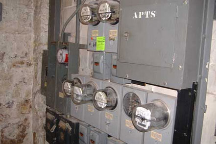 Photo 2. Old service is 50 or 60+ years old, with some modern meter enclosures.