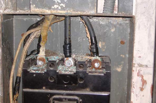 Photo 4. Remove the circuit breaker cover, view corroded line-side terminations—decide that operating this CB in not in my personal interest, as now we are standing in front of a hazardous location per NFPA 70E based on present available fault current of 58,700 amps!