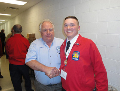 Photo 5. Residential Gold Medal. Jack Jamison proudly shakes the hand of the Gold Medalist for the residential wiring section of SkillsUSA WV.