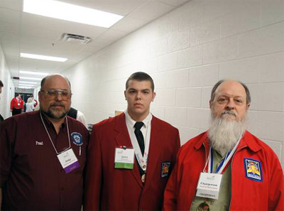 Photo 6. Motor Control Gold Medal. Paul Linger and Jim Williams proudly present the Gold Medalist for the motor control section of SkillsUSA WV.