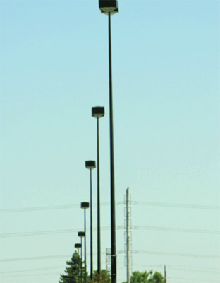 Photo 4. The parking lot luminaires shown here were supplied by load-side branch circuits that did not include an equipment grounding conductor. The installers thought that a ground rod installed adjacent to each pole would accommodate the problem.