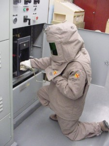Photo 5. Your first choice should always be to work de-energized. If you must work energized, wear your approved personal protective equipment (PPE). This person is prepared should a problem occur.