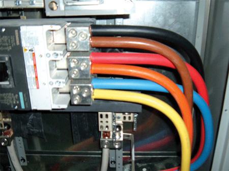 Photos 3 and 4. Various ways of conductor identification for feeders, some code-compliant and some not so.
