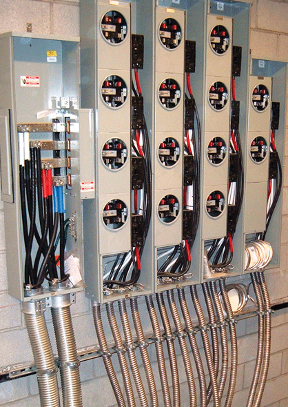 Photo 6. MC feeders feeding into and out of metering distribution equipment in a multi-dwelling high rise project.