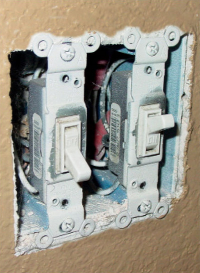 Photo 1. Switch boxes installed in noncombustible material such as gypsum are allowed to be flush or up to a 6 mm (1/4 in.) setback.