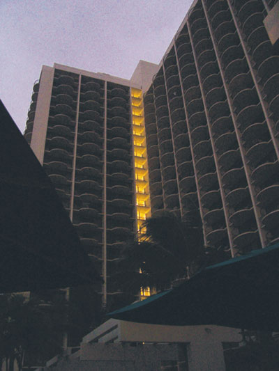 Photo 1. This photo was taken by Mark Hilbert after an earthquake in Hawaii. The entire island was without power because the utility generators sensed the movement and shut down. The only thing illuminated in the entire hotel was the stair tower.