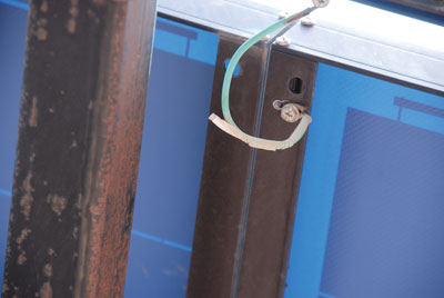 Photo 5. Right grounding point; wrong hardware and method.