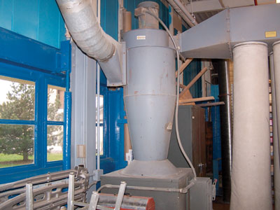 Photo 3. Typical dust collection system (equipment shown inside of structure)