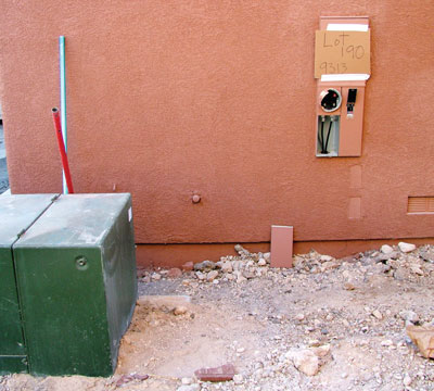Photo 1. This photo shows the service point, which is at the conductor terminations below the meter.