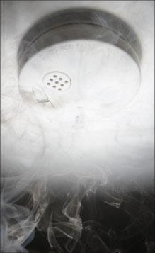 Photo 1. Smoke alarm check.
