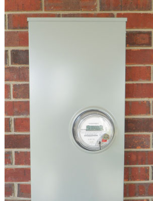 Photo 1. A 400-ampere, single-phase meter enclosure located at the front entrance of a church and preschool. Men, women, and children visiting this location walk by this meter enclosure on a daily basis. What's located behind the cover could prove deadly! And chances are it will not be discovered until there is a problem.