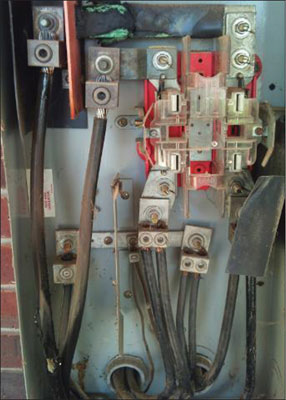 Photo 2. Within the meter enclosure unknown to daily passersby are several potential dangers as can be seen, such as corrosion, effects of overheating to busbars and conductors, insulation failure as well as conductor damage.