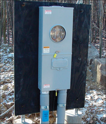 Photo 6. This electrical service location has a meter blank installed and the meter retired or taken out of service. This could be due to non-payment for services, tampering or because the electrical equipment is no longer in service.