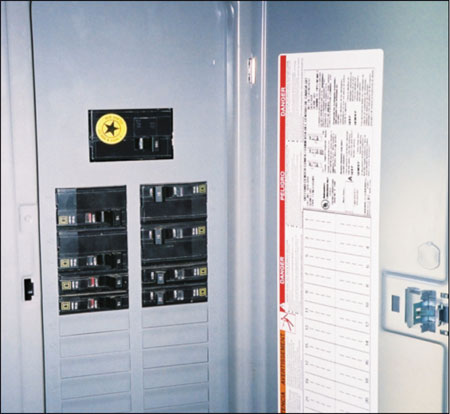 Photo 1. Load Center/Panelboard. Rated at 100 amps with 160 amps of supply breakers