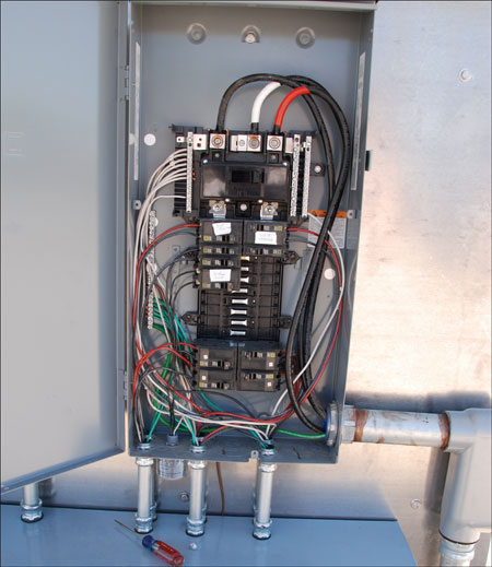 Photo 2. Panelboard with PV breakers in the correct location — opposite the main lugs.
